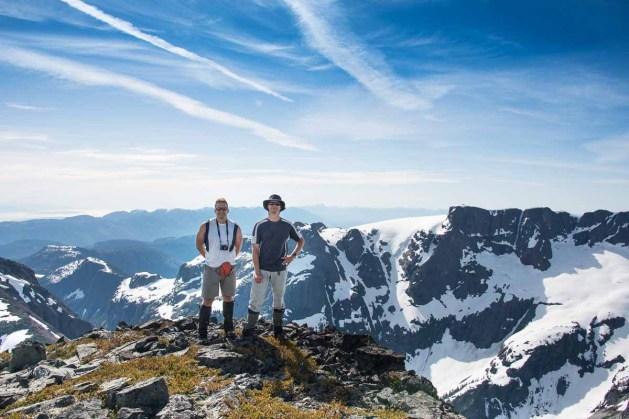 Phil and Matt standing on iceberg Peak, Comox Glacier in the background