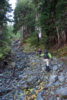 following the rocky watercourse, on route to Peak 5800.