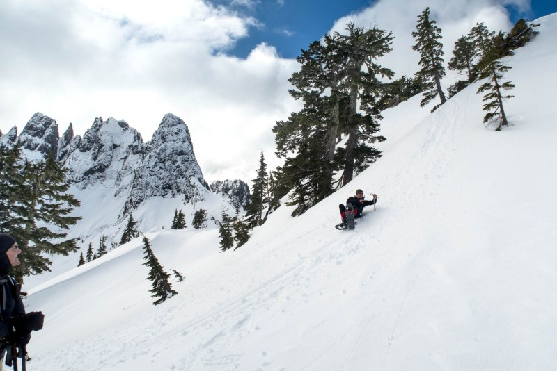 a man slides down an icy slope in the Mackenzie Range
