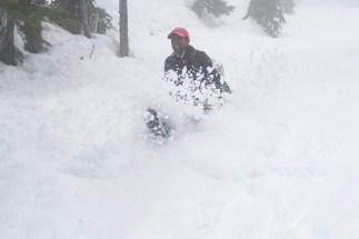 Rishin descending via a butt-slide on Mount Adam