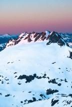 Sunrise illuminating Nine Peaks and the Beauty Glacier hiking to Big Interior Mountain in Strathcona Park