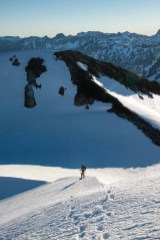 a man descending from Big Interior Mountain in Strathcona Park