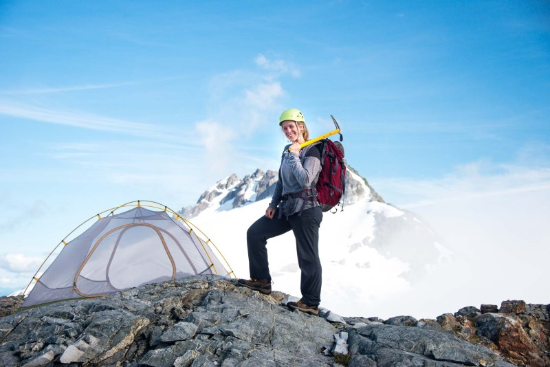 a mountaineer preparing for an evening summit of Nine Peaks, in Strathcona Park