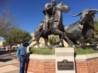 Dennis at John Chisum Statue in Roswell