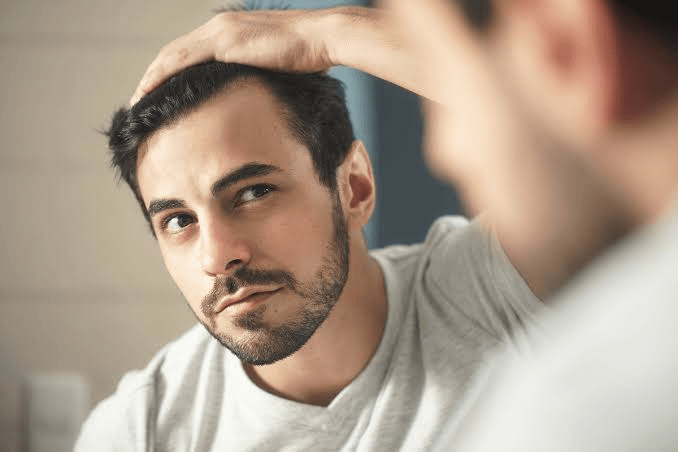 hairstyle for guys with big foreheads