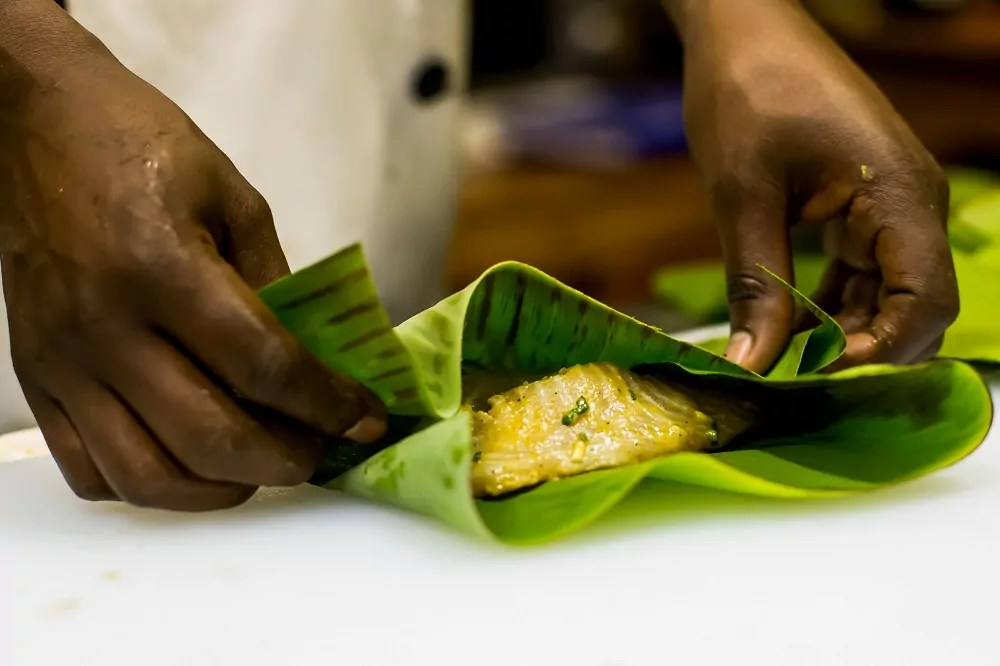 Tilapia steamed in banana leaves Chameleon Hill Lodge