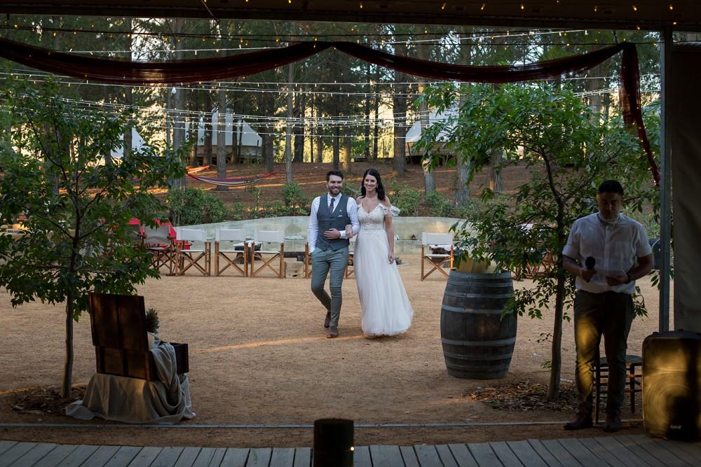 Cherry Glamping wedding bride entering venue