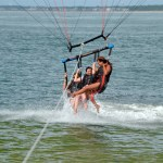 3 People Parasailing - dip in the ocean