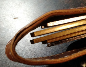 Leather splitting after 9 months (the stitching stops it from completely detaching).