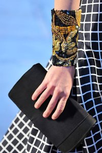 A simple clutch at Dries SS09 with an intricate cuff for balance