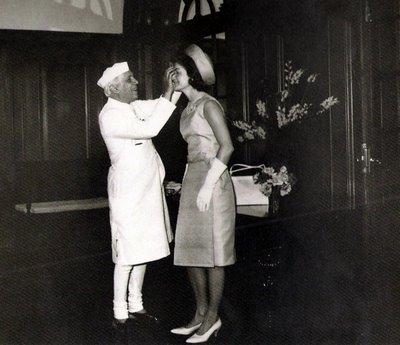Jacqueline Kennedy with Pandit Nehru getting a tilak on exshoesme.com.