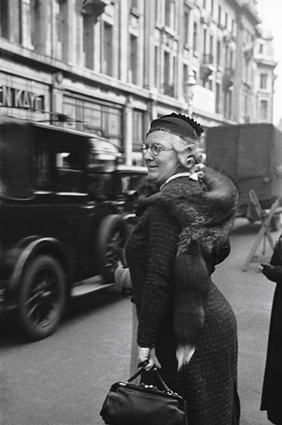 Woman in mink stole shopping in Oxford Street, London, 1934 by E.O. Hoppé on exshoesme.com