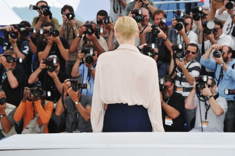 Tilda Swinton and photographers at the 2011 Cannes Film Festival on exshoesme.com. Photo by Pascal Le Segretain-Getty Images Europe.