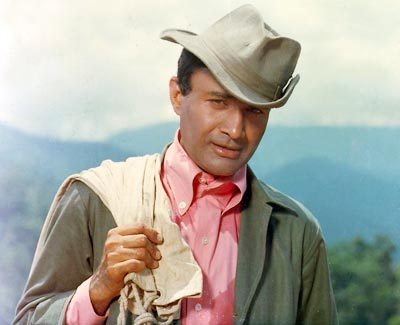 Dev Anand in pink shirt and tipped hat on Exshoesme.com