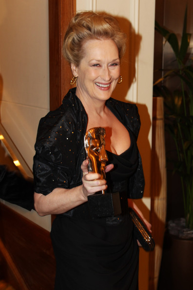 Meryl Streep in Vivienne Westwood holds up her award at the 2012 BAFTAs on Exshoesme.com