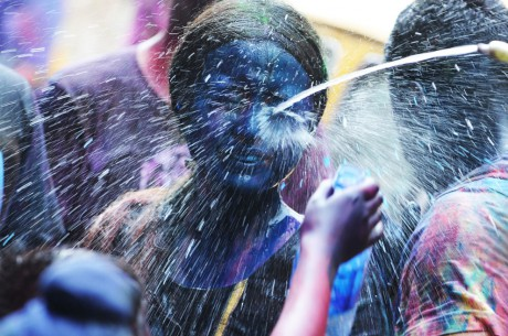 Painted Blue Girl Gets Sprayed with Water during Holi Festivities in Kolkata on March 8, 2012. Photo by Dibyangshu Sarkar-AFP-Getty Images