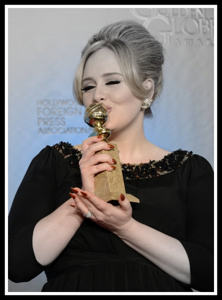 Adele kisses her Golden Globe at the 2013 Golden Globe Awards on Exshoesme.com. Photo Kevin Winter