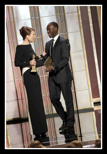 Julianne Moore accepts her award from Don Cheadle at the 2013 Golden Globe Awards on Exshoesme.com Photo Handout Getty NA