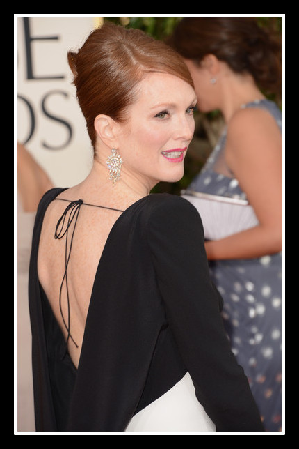 Julianne Moore shows off the back drape of her Tom Ford Gown at the 2013 Golden Globe Awards on Exshoesme.com Photo Jason Merritt