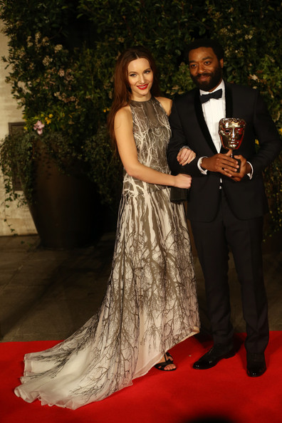Sari Mercer with Chiwetel Ejiofor at the 2014 BAFTAs on Exshoesme.com. Chris Jackson Getty Images Europe photo