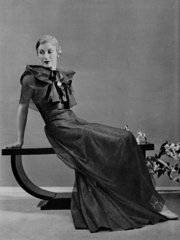 Dorvyne Mlle Boecler in a gown of somber green tulle and satinExcelsior-Modes vol. 5, no. 19, Spring 1934