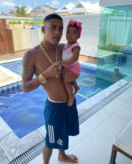MC Poze with her daughter at her home in Recreio