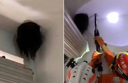 Girl gets her head stuck from the roof of her house and needs rescue