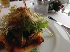 Seafood risotto cake with salad.