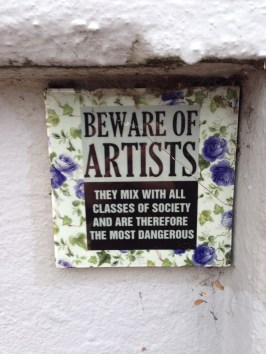 A plaque cleverly hidden in a car park in Chiswick.