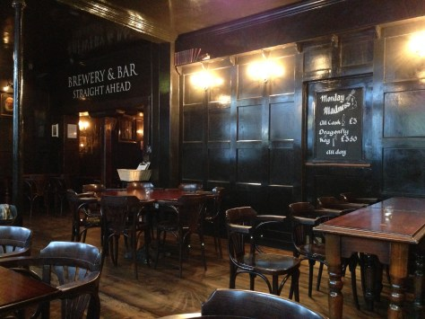 The warm wood surroundings of this historic bar.