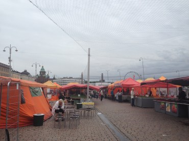 Grey skies and orange tents in the Market Square on the water.