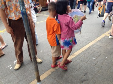 This adorable duo nearly ran into that pole as they tried to navigate the maze of stalls.