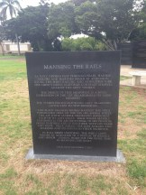 The black plaque detailing the artistic reason behind the design.