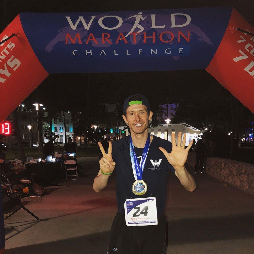 Greg Nance at the World Marathon Challenge finish line in Miami, after running 7 marathons in 7 days on 7 continents.