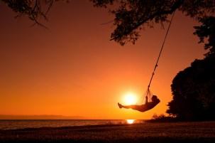 Beach swing at sunset, Pumulani, Lake Malawi