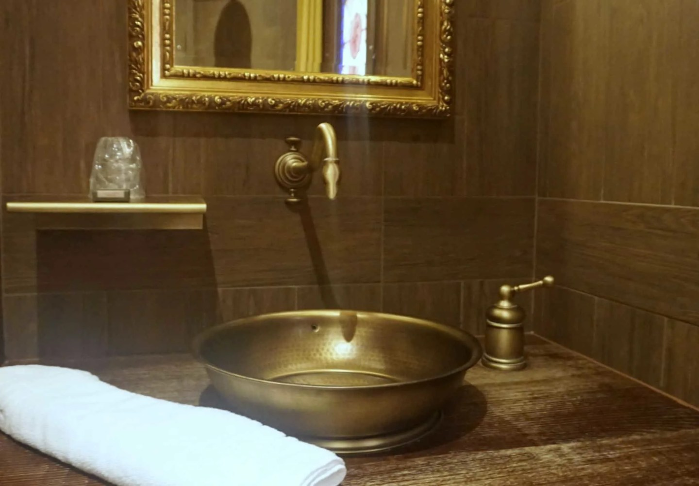 Contemporary but themed bathrooms in Le Camp Du Drap D'Or at Puy Du Fou