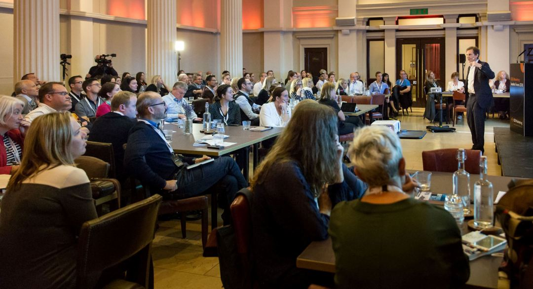 Brad presenting to a business audience in London