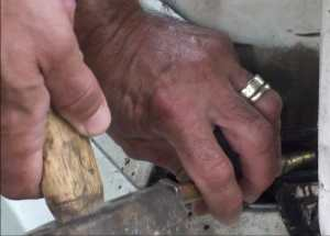 Tapping on stuck drive shaft