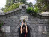 Documenting a well-adorned crypt, Sleepy Hollow Cemetery, New York