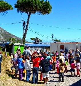 ER volunteers lead a Christmas Party in the South African informal settlement of Red Hill.