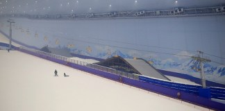 Holidaymakers enjoy skiing at the Harbin Wanda Ski Park,