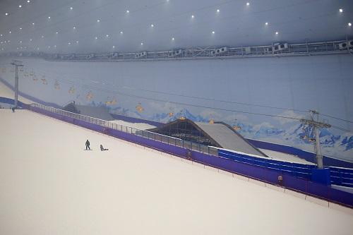 Holidaymakers enjoy skiing at the Harbin Wanda Ski Park,