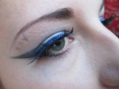 False eyelashes with blue glitter liner duo!