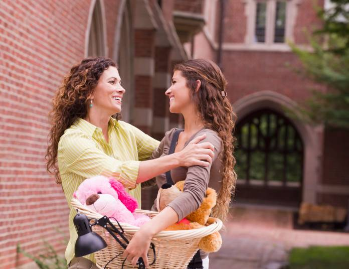 Mother and daughter hug going to college