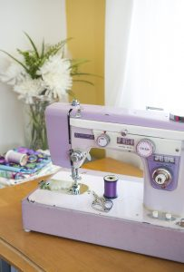 Stevie, Lillyella Stitchery's mythical purple badged sewing machine.