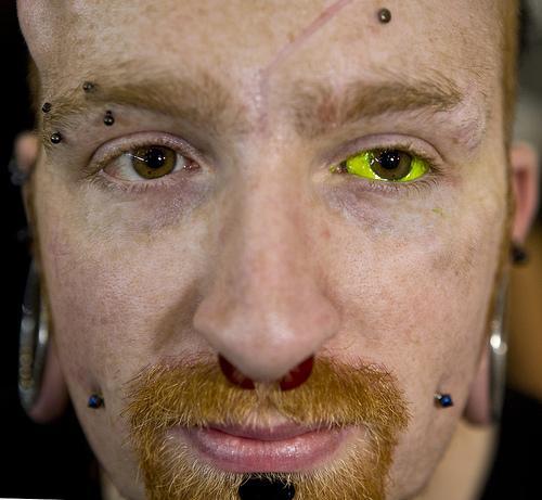 Yellow eyeball tattoo