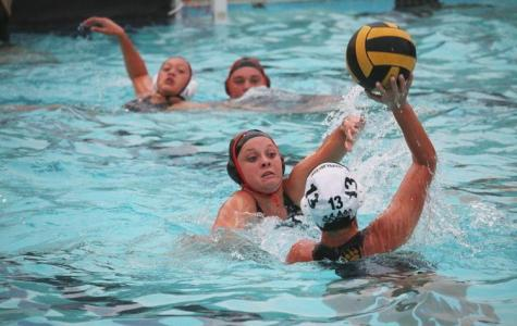 (GEORGE HUGHES/EYE OF THE TIGER) Sophomore captain Shannon Young defends a Ponderosa attacker in the girls' 11-9 comeback win last Monday.