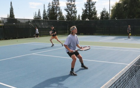 (GEORGE HUGHES/EYE OF THE TIGER) Doubles pair seniors Clay Bradley, front, and Braden Triplett, back left, await their opponent's volley at practice last week. The duo is undefeated in league play and has been a major factor in the team's historical 7-3 start to the league season.