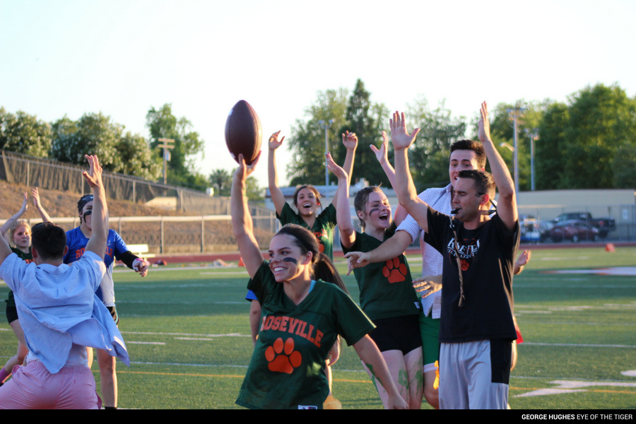 (GEORGE HUGHES/EYE OF THE TIGER) Senior Anna Ostrom celebrates the last second touchdown with her senior coaches.