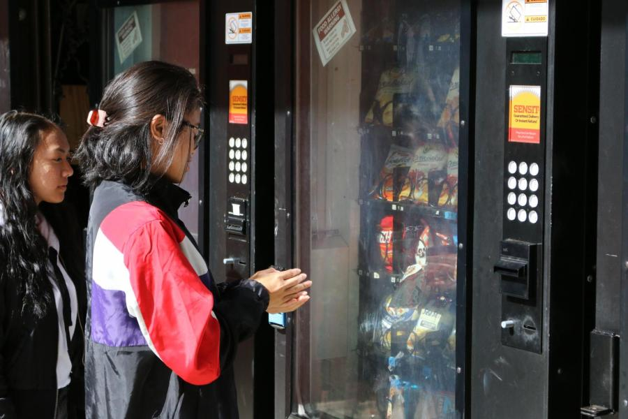 The center vending machine in Senior Square rejects junior Khaeilene Epan in an attempt to purchase a snack. (SINO OULAD DAOUD/EYE OF THE TIGER)